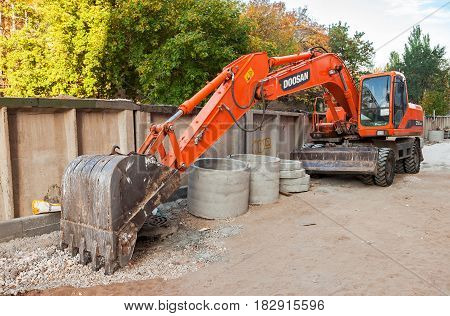Samara Russia - september 26 2015: Doosan wheel excavator parked on the street in summer day