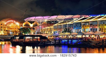 SINGAPORE - APR 5: Clarke Quay at night with street view and restaurant on April 5, 2013 in Singapore. As a historical riverside quay, it is now the hub of Singaporean nightclubs.