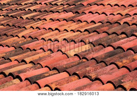 A clay tile roof creating  interesting patterns and perspectives