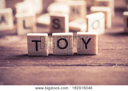 wooden elements with the letters collected in the word toy