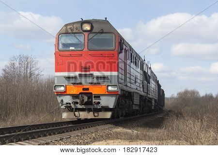 shot of red locomotive of freight train