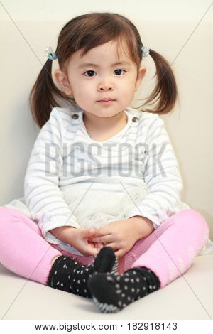 Japanese Girl Sitting On The Sofa (2 Years Old)