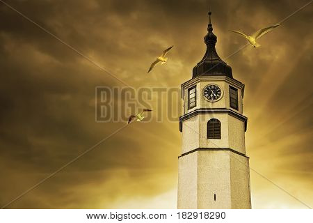 Clock Tower in Belgrade on a background of gloomy sky.