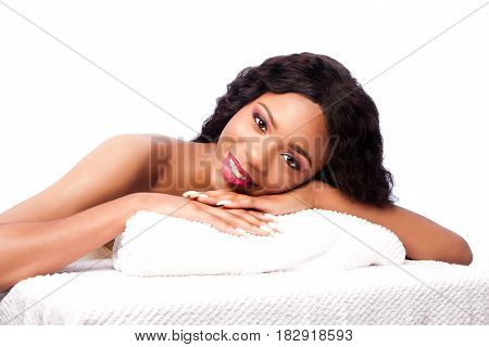 Beautiful Woman At Spa Laying On Towels