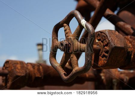 A rusting regulator valve on old machinery in downtown Llano, Texas