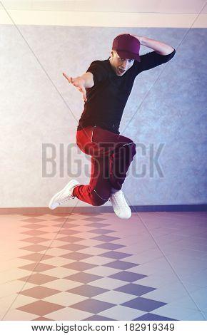 Handsome young hip-hop dancer in studio