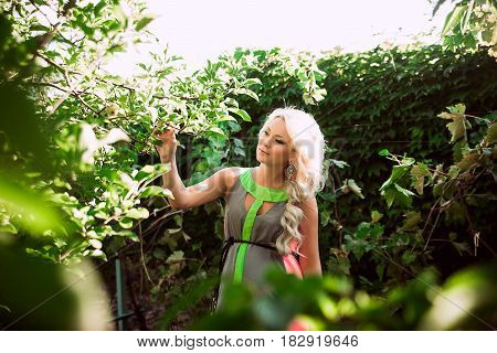 Pregnant Woman In The Garden