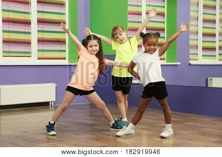 Cute little girls dancing in choreography class