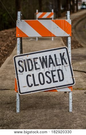 Sidewalk Closed Sign Askew on Stand Full Frame Vertical