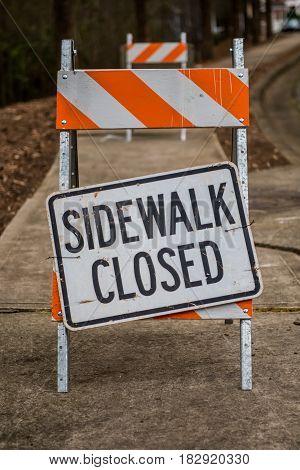 Sidewalk Closed Sign Askew on Stand Full Frame Vertical