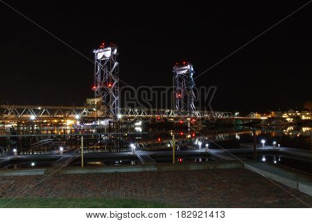 The Memorial Bridge in downtown Portsmouth New Hampshire, at night.