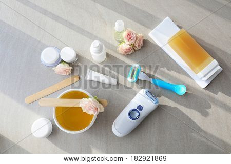 Set for hair removal on grey background