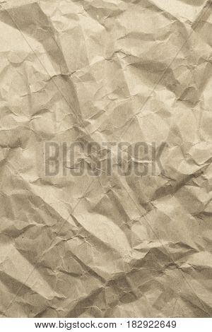 The brown wrinkled paper texture as background
