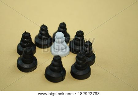 Discrimination harassment middle class defense extremism concept. Chess pawn pieces photo