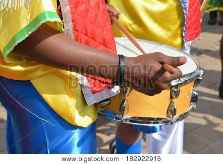 African musician playing drum in festival. Close-up
