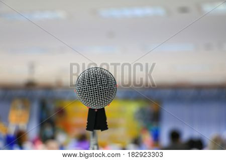 microphone of conference hall or seminar room blurred background :Select focus with shallow depth of field.