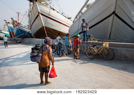 Jakarta, Indonesia - september 9, 2015: People near Makassar schooners (pinisi) in Sunda Kelapa, the old port of Jakarta, Indonesia