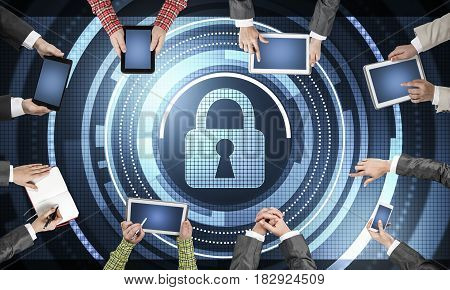 Group of people with devices in hands working together and symbol of net security and protection
