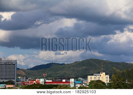 landscape city top view and skyline with gathering storm clouds