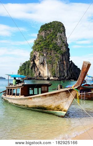 RAILAY BEACH, KRABI, THAILAND - 24 December  2016: Tourists use long tail boats to visit the famous beaches of Thailand.
