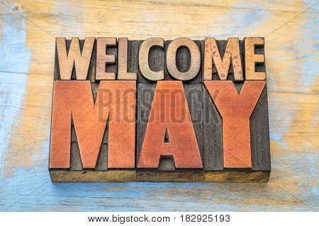 Welcome May banner - word abstract in vintage letterpress wood type blocks