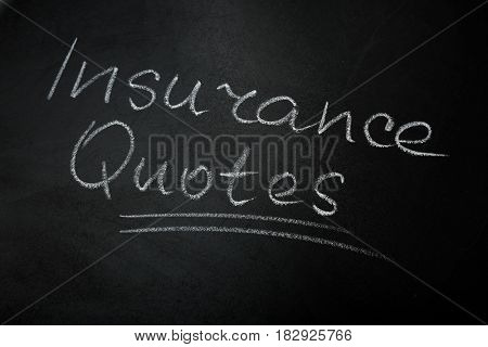 Text INSURANCE QUOTES written on blackboard background