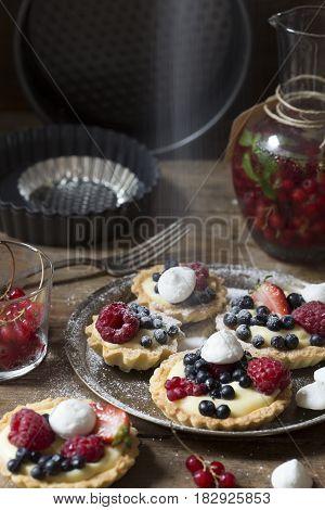 Fruit tarts on a vintage brass tray