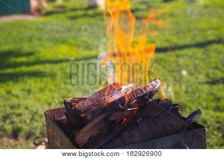 Brazier fire hand evening long exposure iron sparks