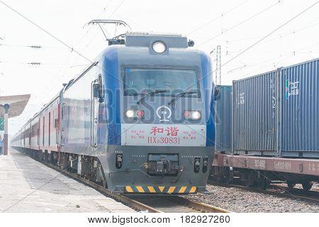 Henan, China - Aug 21 2015: China Railways Hxd3 Electric Locomotive In Lingbao Railway Station, Hena