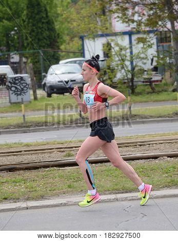 BELGRADE, SERBIA - APRIL 22: An unidentified woman runs in 30th Belgrade Marathon on April 22, 2017 in Belgrade, Serbia