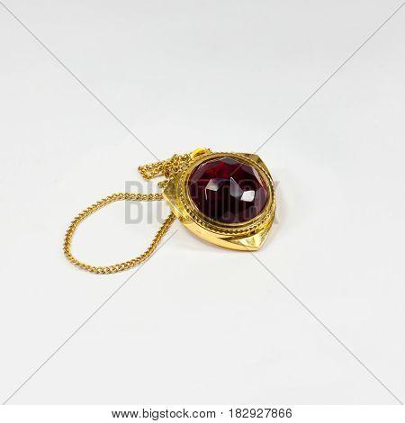 Antique gold watch on white background. Locket