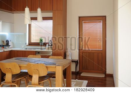 Horizontal view of modern furniture in luxury kitchen from high quality wood