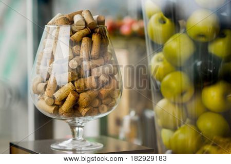 large glass corks. decorated. apples in a vase