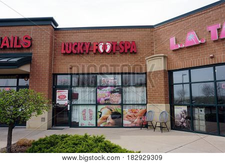 BOLINGBROOK, ILLINOIS / UNITED STATES - APRIL 14, 2017: One may have one's feet massaged at the Lucky Foot Spa in the Concord Plaza in Bolingbrook.