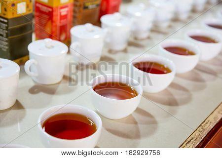 Ceylon tea degustation cups closeup view