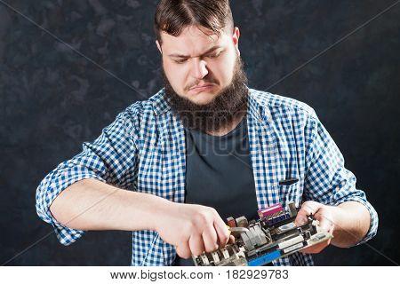Technician engineer repair pc motherboard