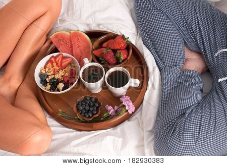 Lovely Young Couple Having Breakfast In Bed