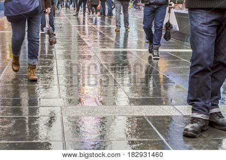 Walking in New York City after the rain with reflections on the concrete