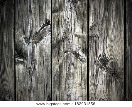 Weathered gray wood boards with knotholes background.