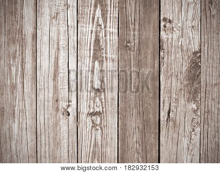 Weathered, vintage brown wooden planks boards background.