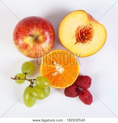 Fresh Ripe Fruits On White Background