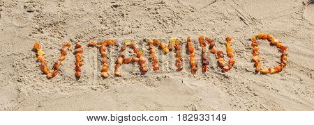 Inscription Vitamin D On Sand At Beach, Summer Time And Healthy Lifestyle