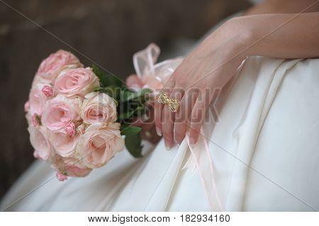 Wedding bouquet in bride's hands. Wedding day
