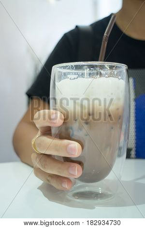 Glass Of Iced Milk Coffee Drink stock photo