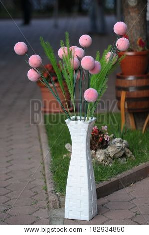 Wedding decorations with bench flowers composition on ceremony place