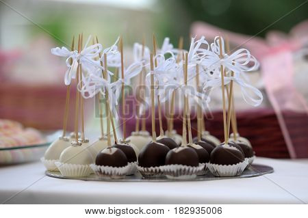 Miniature wedding desserts filled with truffles and decorated with cream