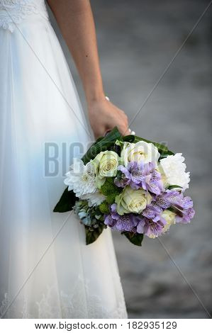 Wedding bouquet with flowers in brides hand