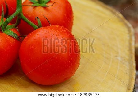Red Fresh Large Organic Tomatoes Dew Drops On Wood Concrete Background.