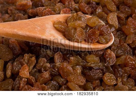 A scattering of raisins. Raisin Background. Fresh raisins.