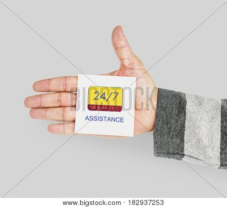 Hand with 24/7 service note in the palm